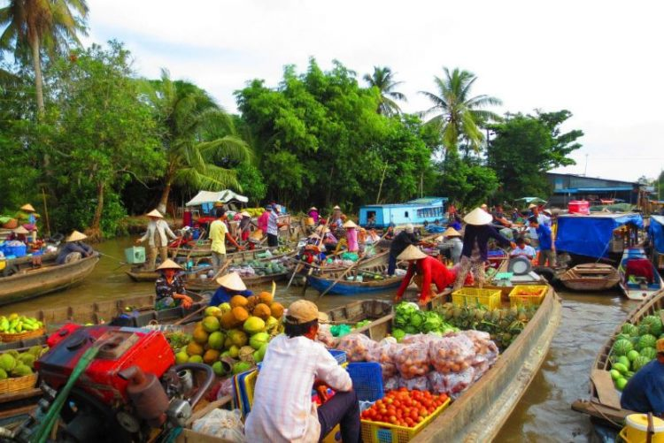 cai be floating market day trips from ho chi minh city